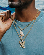 iced out praying hands and iced eagle set on franco chains