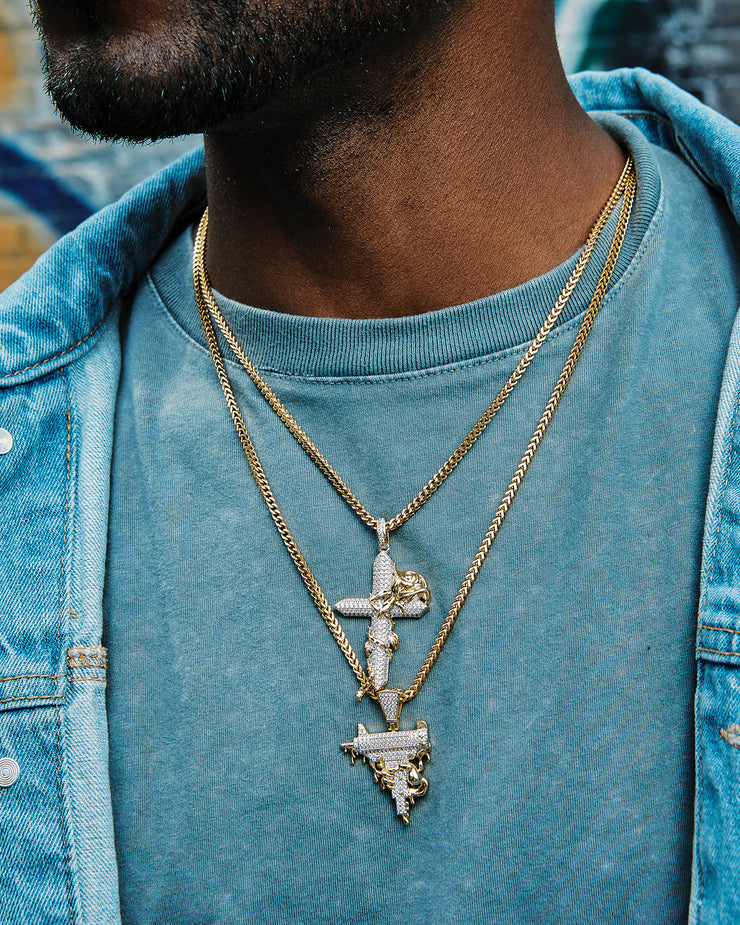 iced out uzi pendant and iced rose cross pendant set on franco