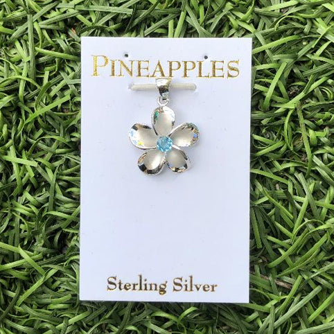 Small Sterling Silver Plumeria Pendant with Blue Topaz center