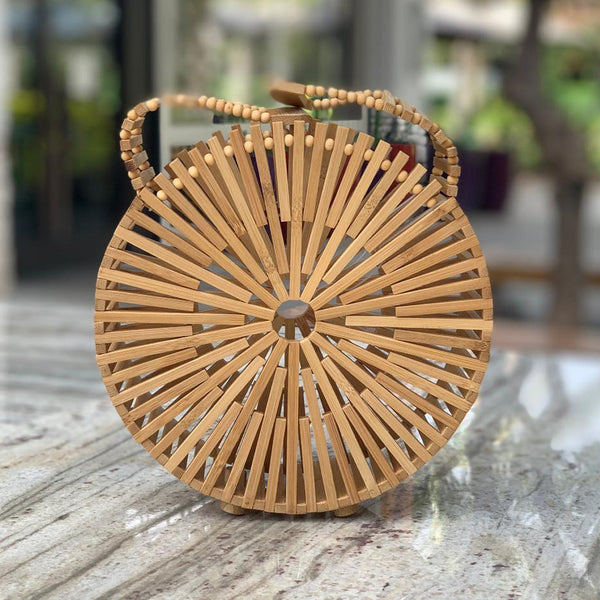 Tenganan Bag: Round bamboo bag with flexible handles & little bottom footing