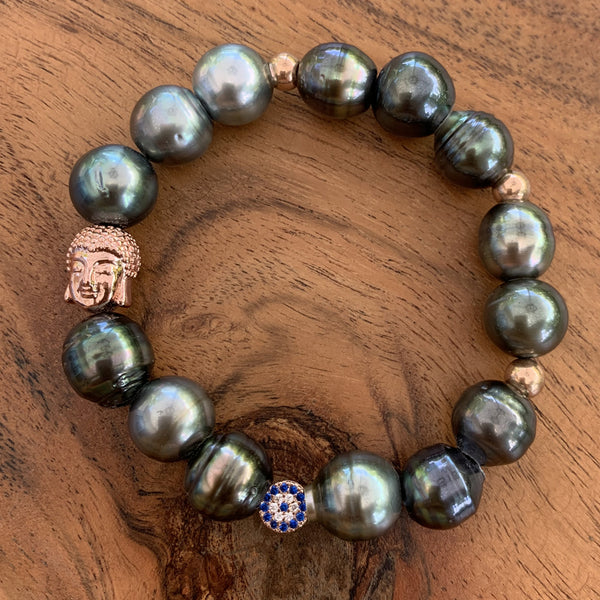 Elastic Tahitian Pearl Bracelet with Silver Rose Gold Plated Buddha Charm and Evil Eye Blue CZ Charm.