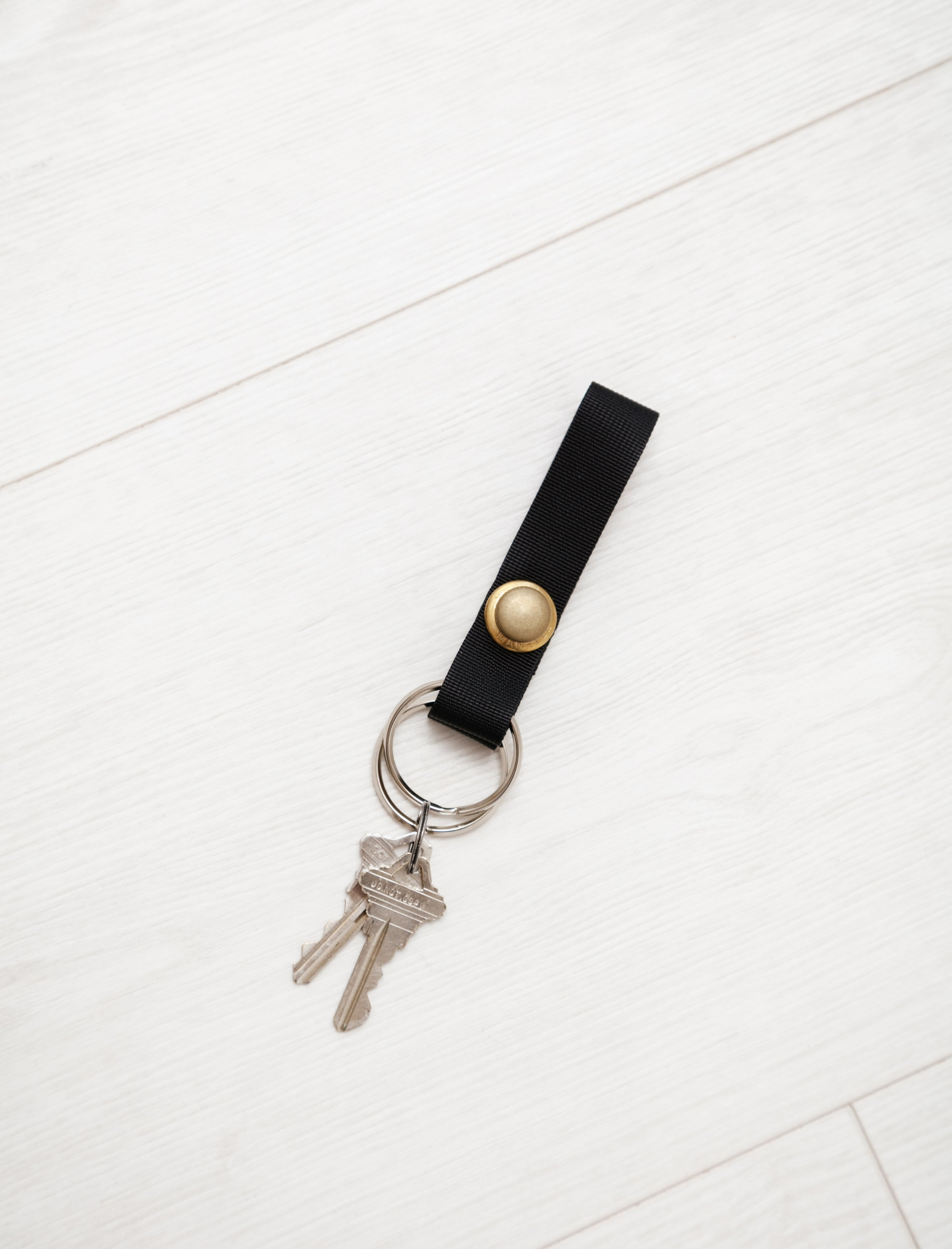 MAN-TLE Short Snap Keyring Black Brass