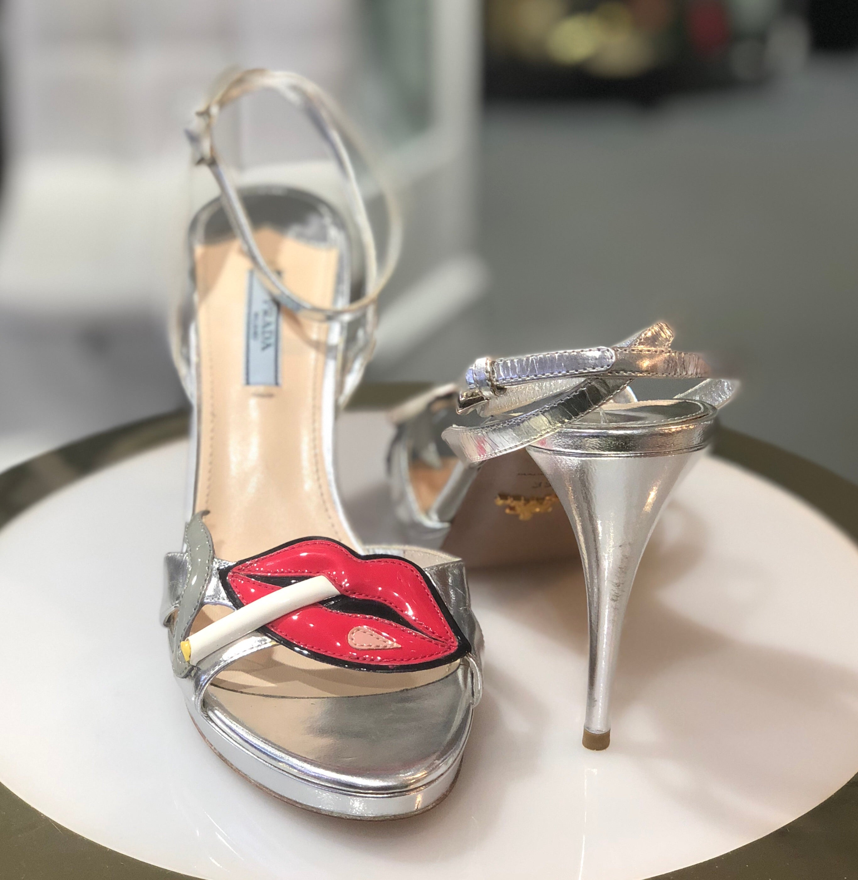 Prada lips and cigarette heels
