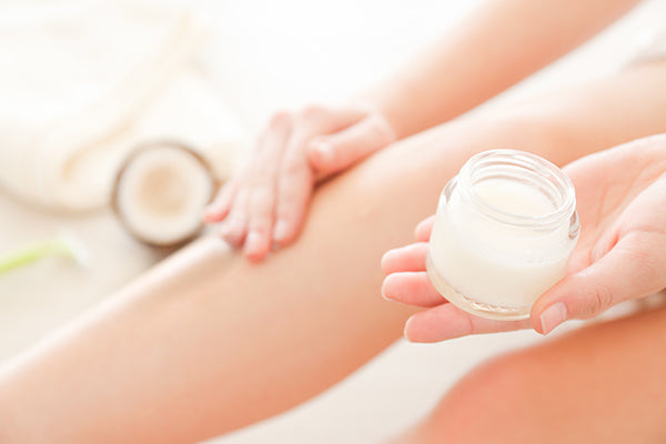 Image of Person applying Elegant after shave cream on her legs