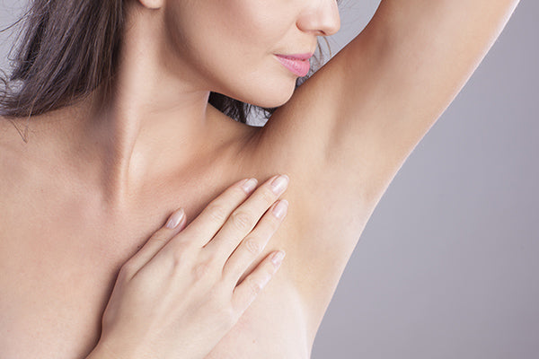 Image of woman having applied after shave gel under arms