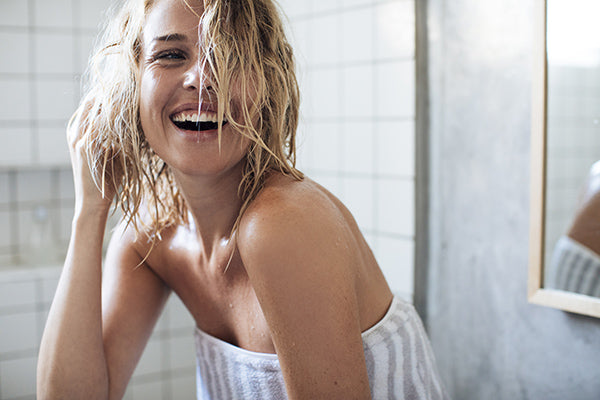 Image of Woman laughing in the Shower