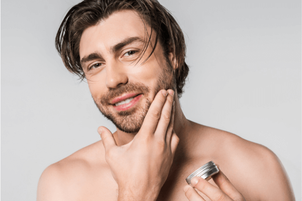 image of a man being applied beard balm