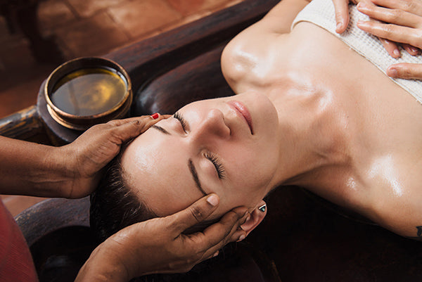 Image of woman getting a massage using classic massage oil blend
