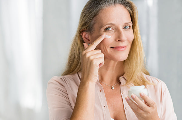 Image of Mature Woman Applying Cleansing Face Cream