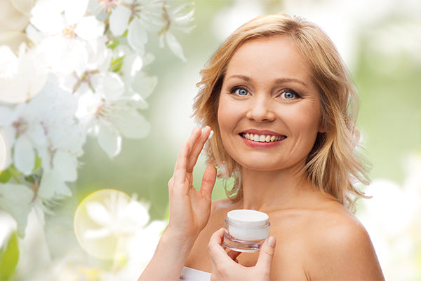 Image o a woman holding a jar of daily moisturiser