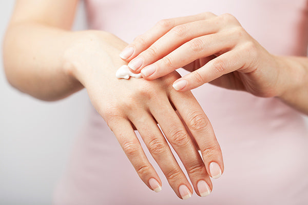 Image of a person using deep conditioning hand cream
