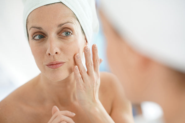 Image of Mature Woman applying Mullein Face Lifting Oil on her Face as part of her Skincare Routine