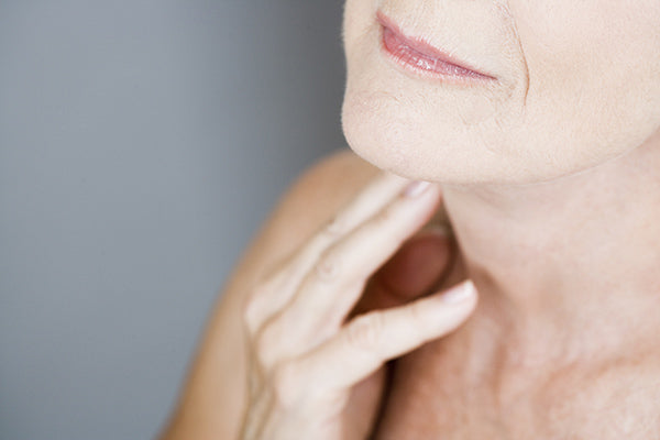 Image of Mature Woman applying Rosehip Oil Blend on her Body / Neck