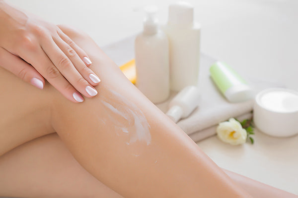 Image of woman applying ultra smooth silk balm on her body / legs