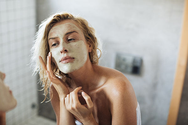 image of a woman using peel off beauty face mask