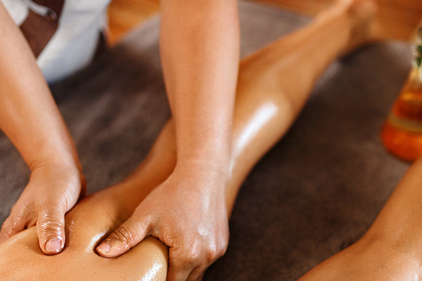 image of someone getting a massage using hazelnut dry legs treatment oil