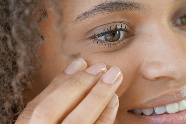 image of a woman applying rich eye cream
