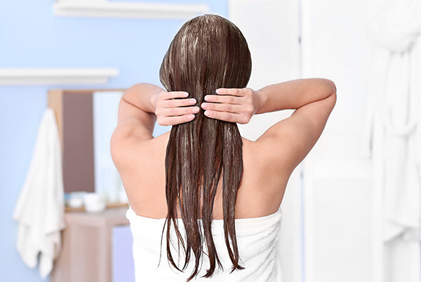 Image of a woman doing a Nourishing Hair Mask