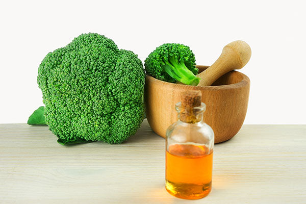 image of high shine hair oil containing broccoli seed oil