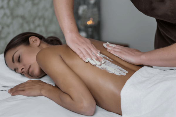 Image of woman getting a massage using Massage Cream