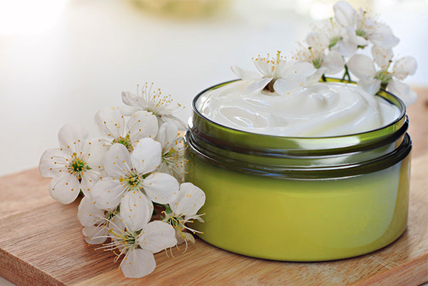 image of jar containing moisturiser for sensitive skin and mature skin