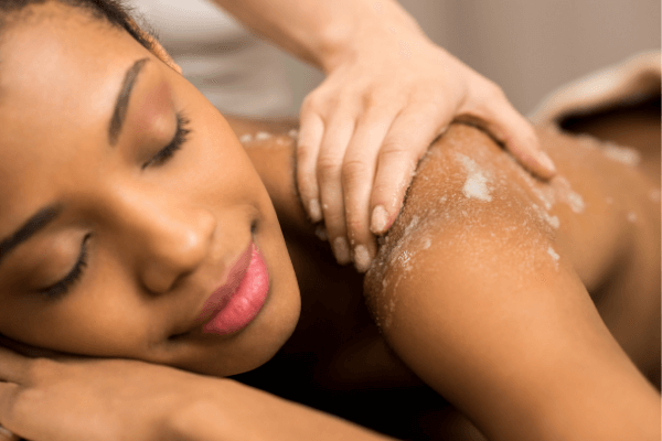 image of oriental exfoliating body scrub being use during a massage