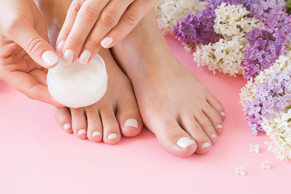 Image of woman about to apply tingle toes foot gel