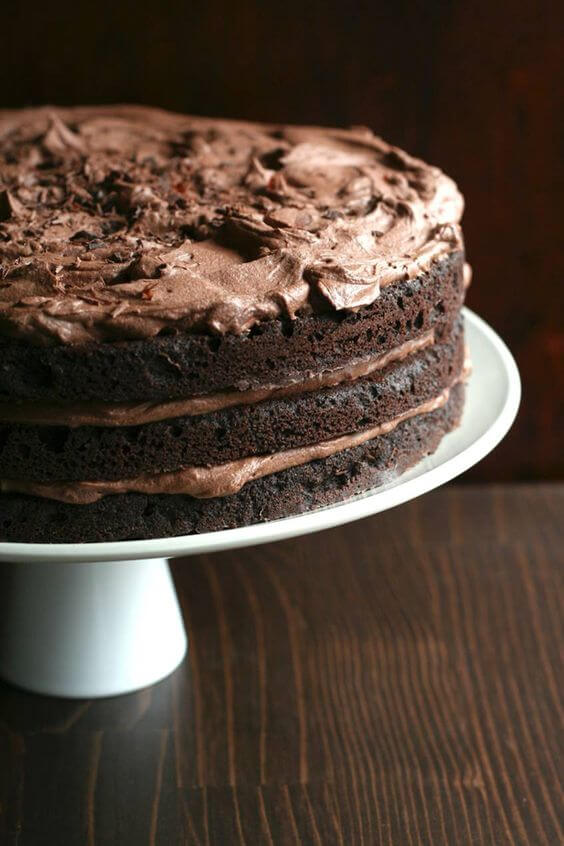 Delicious Low-Carb and keto Chocolate Layer Cake with Whipped Chocolate Ganache Frosting.