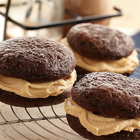 Decadent chocolate whoopie pies with peanut butter cream filling