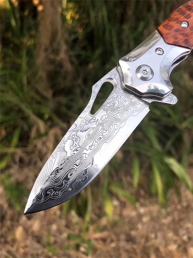 The Arrowshark Damascus steel folding knife