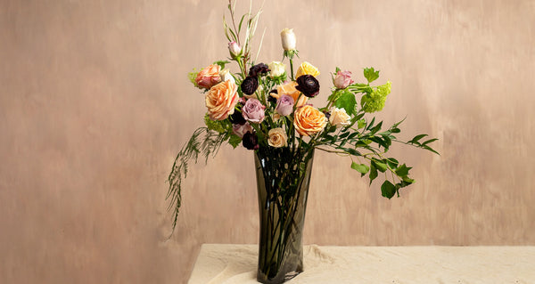 NUDE Inca vase with a mix of flowers in a composition created by florist Grace & Thorn