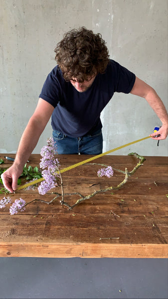 @the_ikebana_project measuring the flowers for the Ikebana creation for NUDE Glass