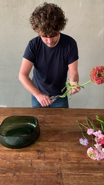 @the_ikebana_project cutting the flowers for the Ikebana creation for NUDE with its Opti Collection