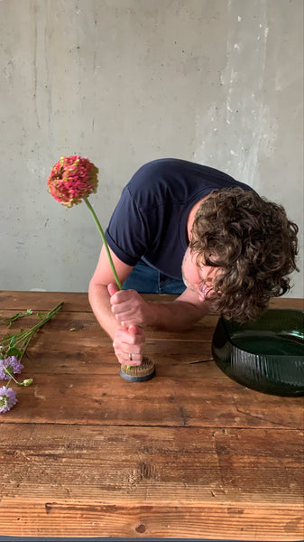 @the_ikebana_project placing the flowers on the kenzan for the Ikebana project for NUDE Glass