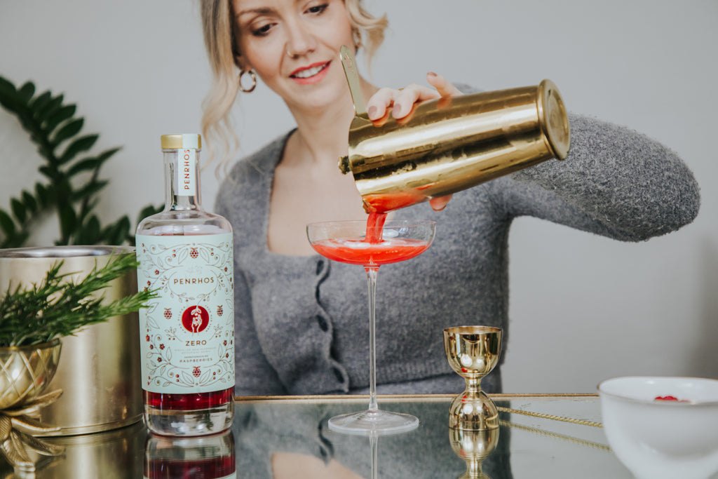 Camille Vidal from Lamaisonwellness.com pouring a mindful cocktail in the NUDE Savage coupe glass