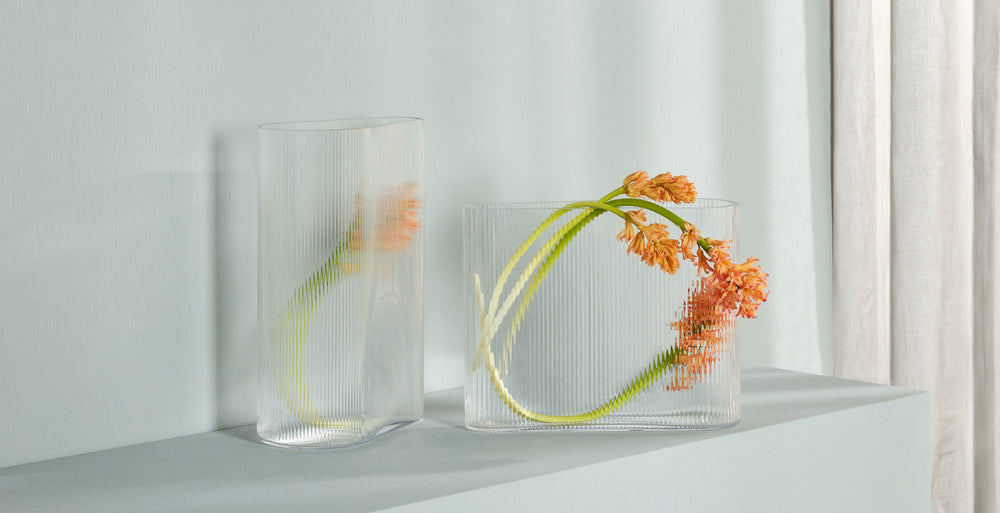 NUDE Glass Mist vases tall and wide in clear, presented with simplistic flowers as decoration