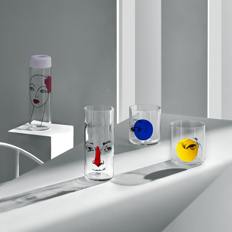 NUDE Finesse Rok & Pop glassware collection with its jugn high ball glass and whisky glass in light neon environment