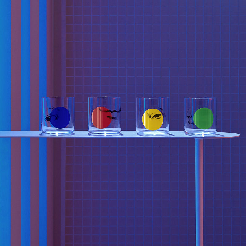 Lifestyle image of NUDE Rock & Pop glass collection with jug, highball glass and whisky glass in dark neon environment