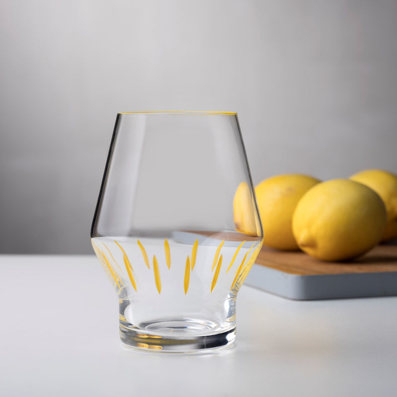 Beak Waterglass Iris Collection Yellow Striped on table setting