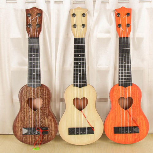 Musical Instrument Mini Ukulele Kids Guita Toys Creative School Play Game Color Random