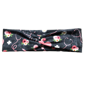 nurse print headband, gray background, pink hearts, stethoscopes, pink and white flowers, white crosses