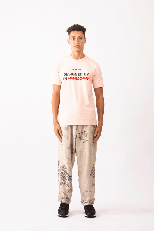 PALE PINK CENSORED DESIGNED BY AN IMMIGRANT' T-SHIRT