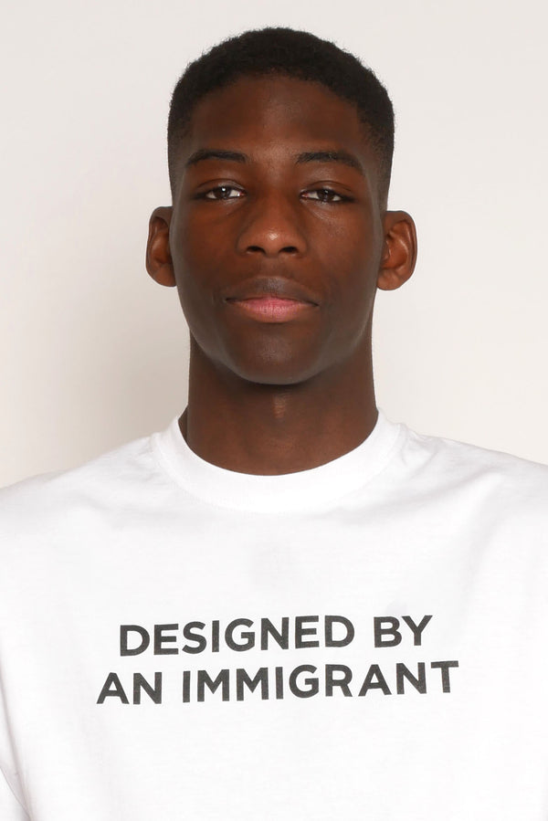 'DESIGNED BY AN IMMIGRANT' T-SHIRT