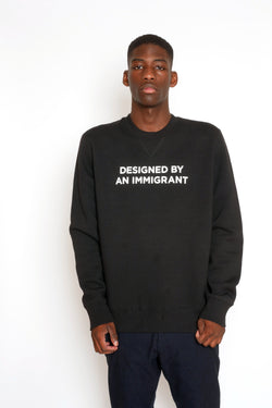 'DESIGNED BY AN IMMIGRANT' SWEATSHIRT