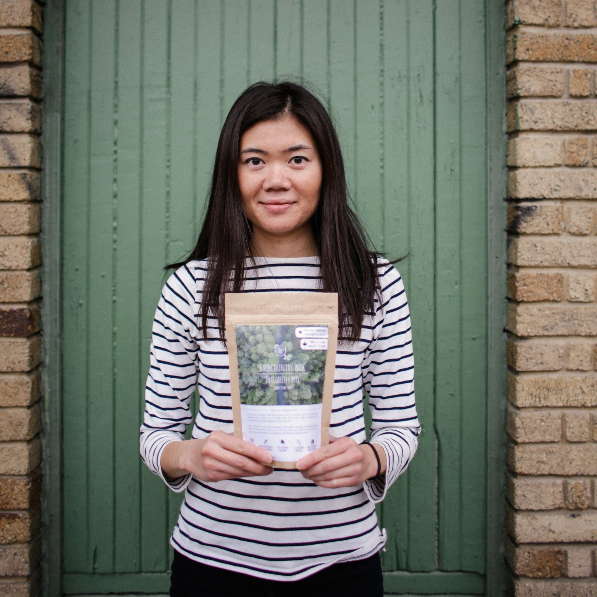 Melanie Ang, founder of Backcountry Work holding one of her products.
