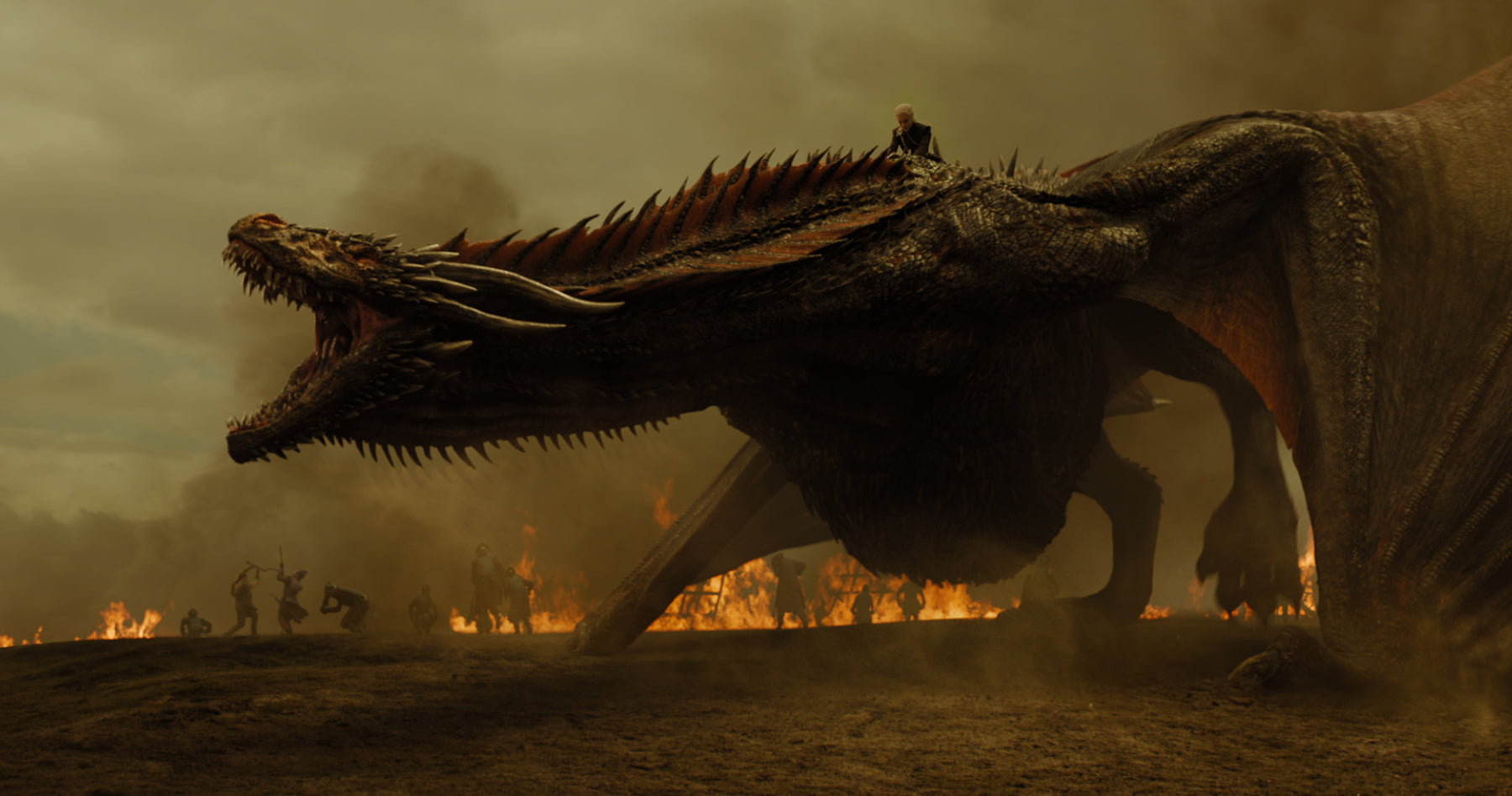 Image of Daenerys Targaryen riding a scaly dragon into a war scene with fires underneath them and people fighting