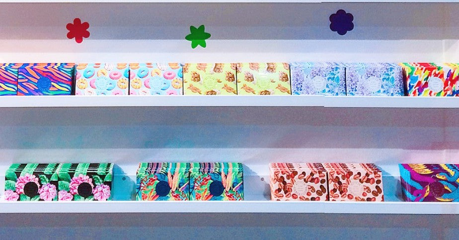 The wall display of Alicja Confections postcard chocolate bars.