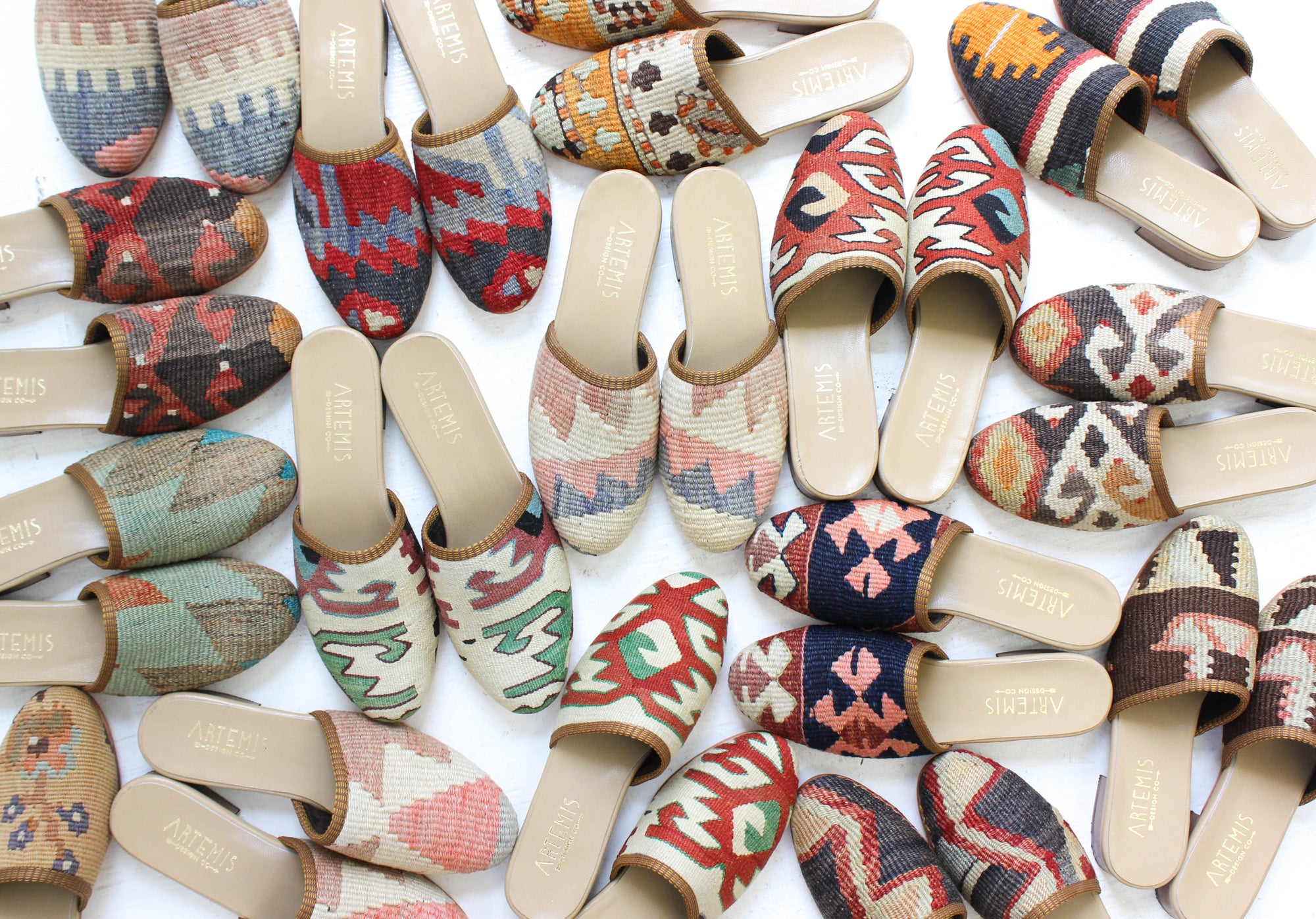 Flat lay image of woven mule-style shoes