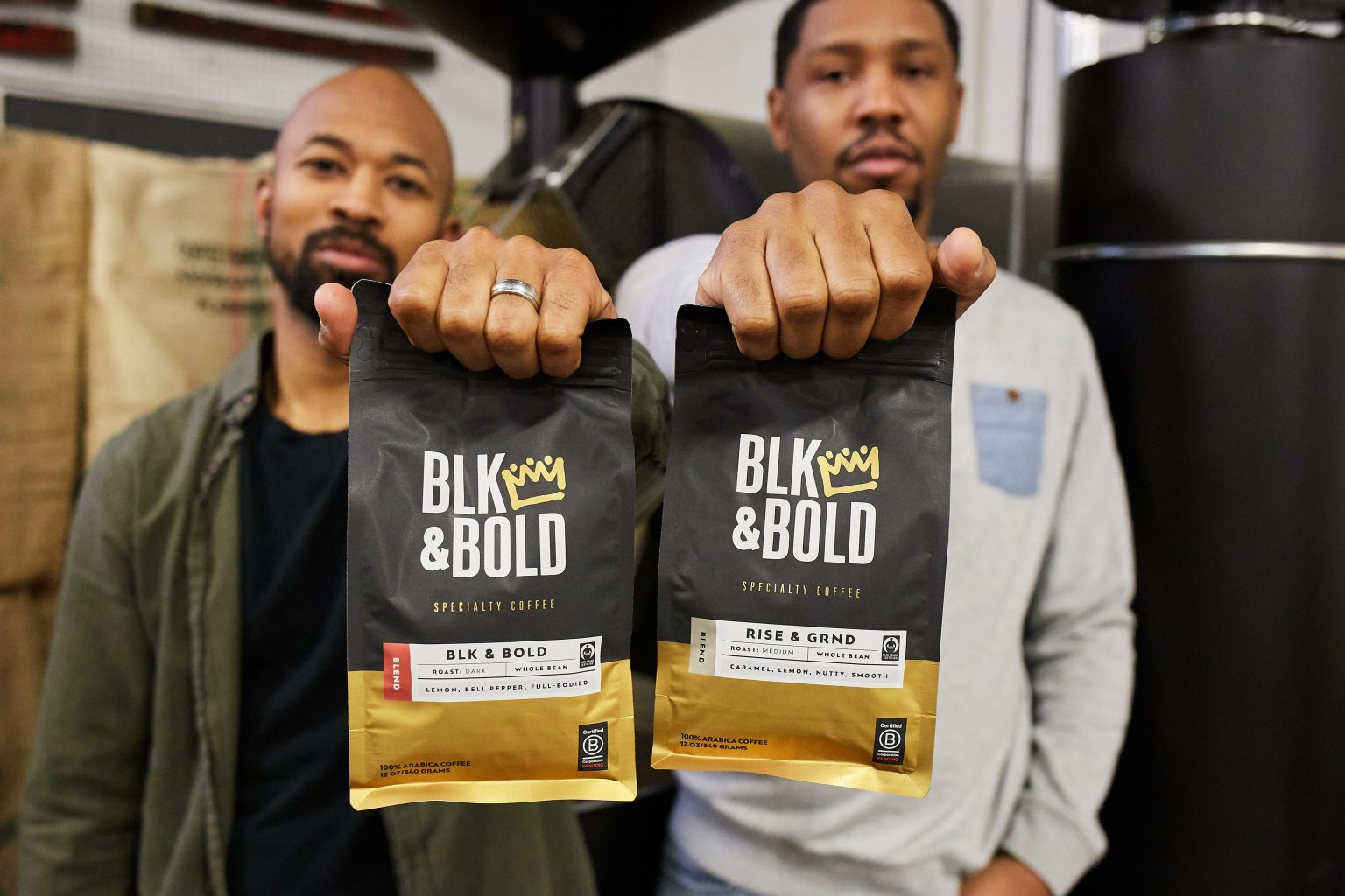 Pernell Cezar (Left) and Rod Johnson holding up bags of their coffee.