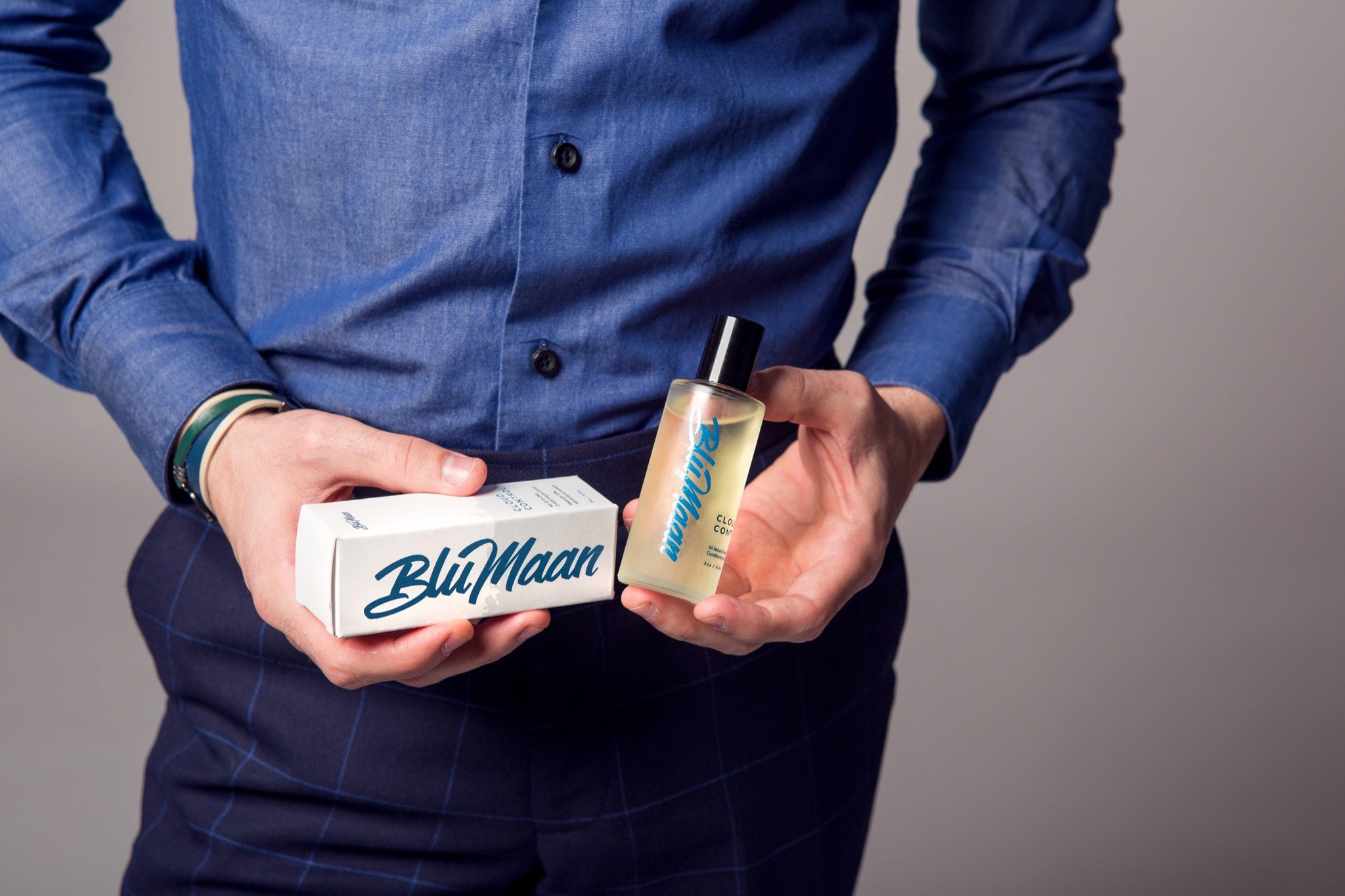 A model holds two products by BluMaan.